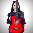 Woman with red guitar — Stock Photo #58257991