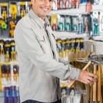 Man Buying Hammer In Hardware Store — Stock Photo #61579449