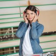 Female Carpenter Wearing Ear Protectors In Workshop — Stock Photo #62423977