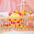 Cots with different soft toys — Stock Photo #57113171