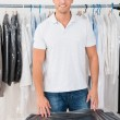 Man Standing In Clothing Store — Stock Photo #73539695