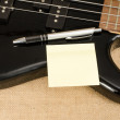 White paper on electric bass guitar — Stock Photo #65451933
