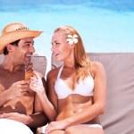 Happy couple on the beach — Stock Photo #78165836