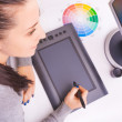 Graphic designer working in office using tablet pen — Stock Photo #62553973