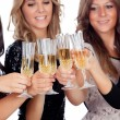 Friends toasting with champagne in Christmas — Stock Photo #56827443