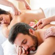 Couple having relaxing body massage in spa. — Stock Photo #70818383