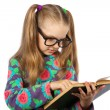Girl with glasses reading a book — Stock Photo #65911665