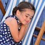 Little gir sleep in outdoor chair — Stock Photo #56127147