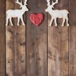 Wooden deer with red heart — Stock Photo #59964209