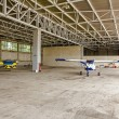 Airplane is parked in the hangar — Stock Photo #56056695