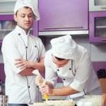 Tiramisu cooking concept. Portrait of two working men in cook un — Stock Photo #65519967