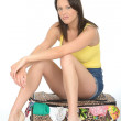 Sexy Miserable Fed Up Young Woman Sitting on a Suitcase Resting Her Arms on Her Knees — Stock Photo #71734749