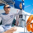 Handsome man on sailing boat — Stock Photo #65658481