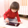 Little boy in red shirt with tablet computer at home — Stock Photo #63380559