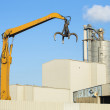 Crane picking up scrap metal in recycling site outdoors — Stock Photo #67630489