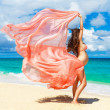 Young pregnant woman with pink cloth fluttering in the wind on a — Stockfoto #63791713
