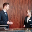 Hotel receptionists behind the counter — Stock Photo #68169753