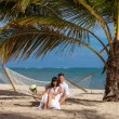 Romantic Couple Relaxing In Beach Hammock — Stockfoto #75818167