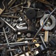 Background from old rusty bolts, screws, nuts, screws, brackets, various metal details — Stock Photo #66613519