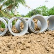 Concrete drainage pipes stacked for construction, irrigation, in — 图库照片 #76201037