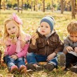 Three happy children playing in autumn park with fruits — Stock Photo #68360873