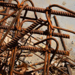 Rusty corroded stained metal pieces: wire, fitting, armature on a dirty concrete floor — Stock Photo #76041657