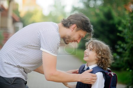 Father escorts to school, first-grader son