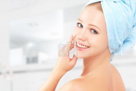 skin care. young beautiful healthy girl in towel in bathroom