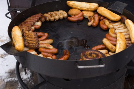 Hot griddle with assorted grilled sausages