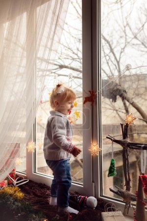 girl with gifts on a windowsill