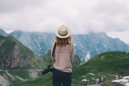 Fashionable girl relaxing outdoor travel freedom lifestyle with mountains on background