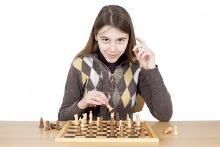 Smart Young Girl Playing Chess - Good Chess Game Requires Intelligence, Patience And Good Strategy