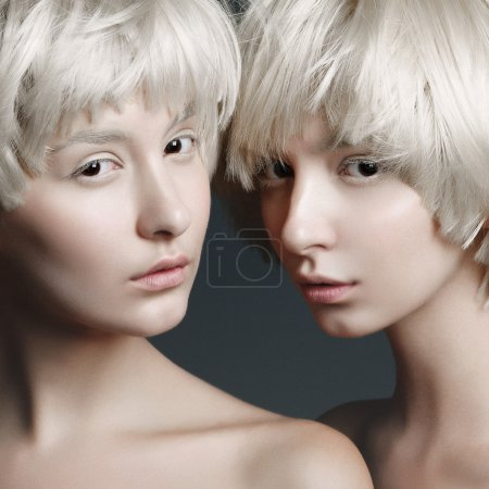Girls with fashion make up and white wigs