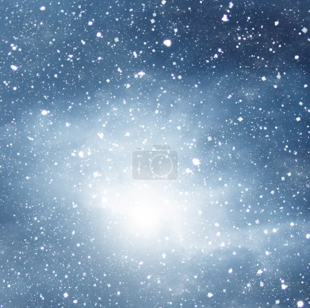 falling snow on the blue background dramatic dark sky background