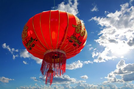 Chinese red lantern against blue sky with clouds