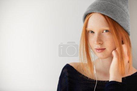 Teenage girl listening to audiobook